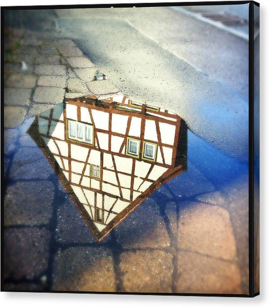 Wet Canvas Print - Old Half-timber House Upside Down - Water Reflection by Matthias Hauser