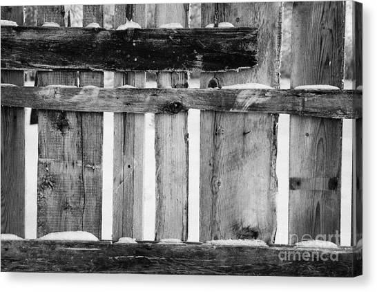 Harsh Conditions Canvas Print - old patched up wooden fence using old bits of wood in snow Forget by Joe Fox