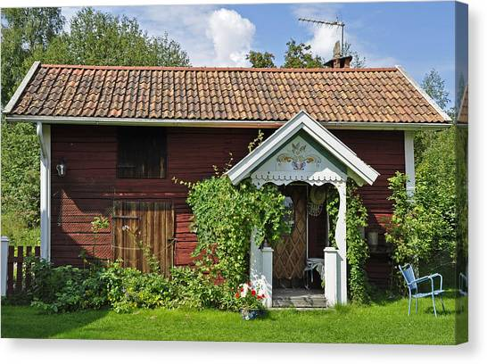 Old Red Wooden Hut Canvas Print by Conny Sjostrom