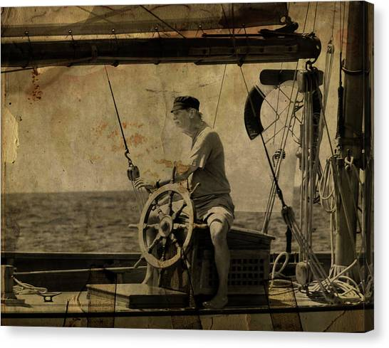 old sailor A vintage processed photo of a sailor sitted behind the rudder in Mediterranean sailing Canvas Print