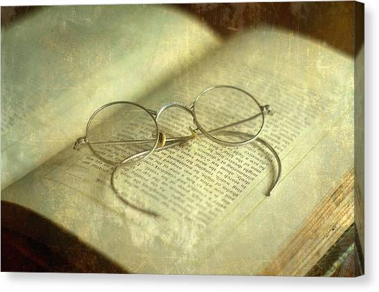 Old Silver Spectacles And Book Canvas Print