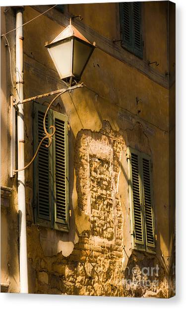 Old Street Lamp And Shuttered Windows In Montalcino Canvas Print