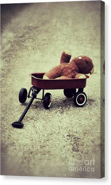 Old Teddy Bear In Red Wagon Canvas Print