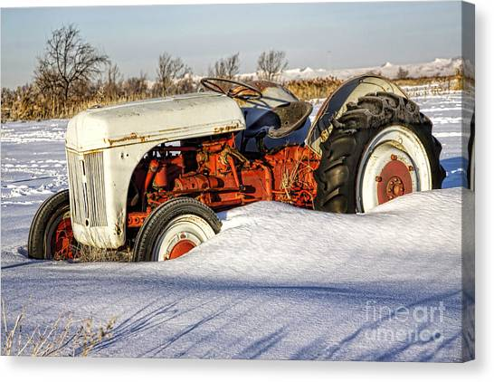 Old Tractor In The Snow Canvas Print