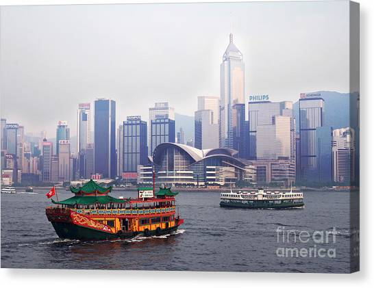 Hongkong Canvas Print - Old Traditional Chinese Junk In Front Of Hong Kong Skyline by Lars Ruecker