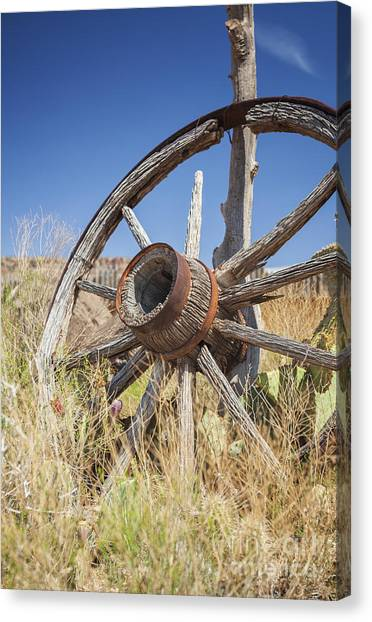 Canvas Print featuring the photograph Old Wagon Wheel by Bryan Mullennix