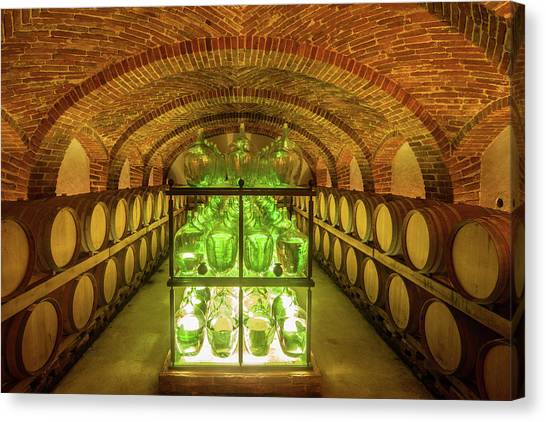 Old Wine Cellar With Barrels And Bottles Canvas Print