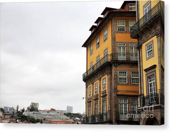 Old World Buildings In  Porto Canvas Print by John Rizzuto