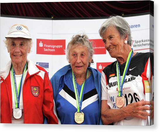 Older Female Athletes On Medals Rostrum Canvas Print by Alex Rotas