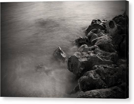 On The Rocks Canvas Print by Fizzy Image