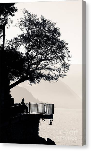One Old Man Sitting In Shade Of Tree Overlooking Lake Como Canvas Print