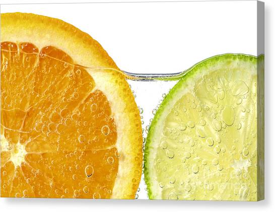 Limes Canvas Print - Orange And Lime Slices In Water by Elena Elisseeva