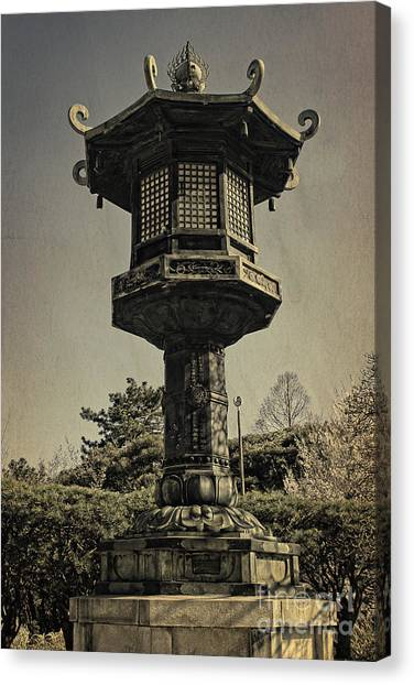 Ornate Lamp Post In Front Of A Buddhist Temple Canvas Print