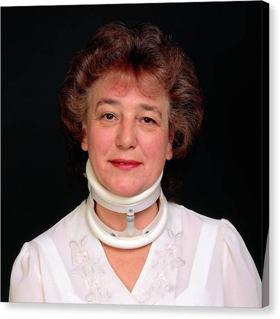 Braces Canvas Print - Orthopaedic Neck Collar On A Woman (summer) by Alex Bartel/science Photo Library