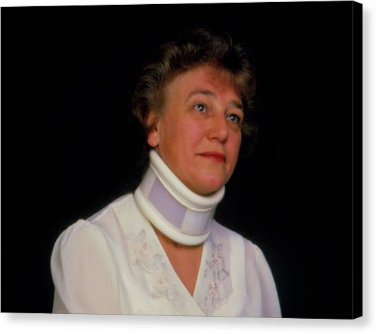 Braces Canvas Print - Orthopaedic Neck Collar On A Woman (winter) by Alex Bartel/science Photo Library