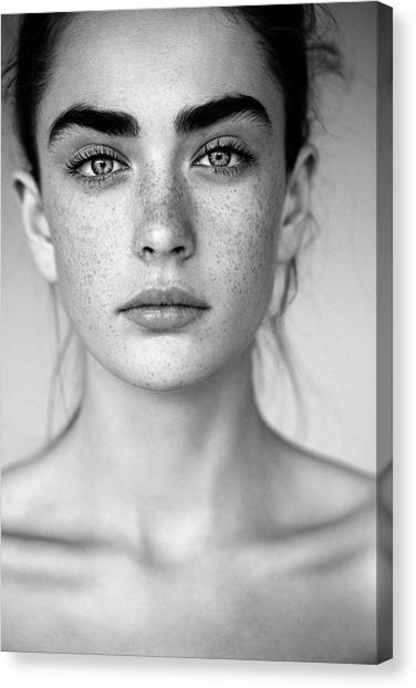 Outdoor Shot Of Young Beautiful Woman Canvas Print by Coffeeandmilk