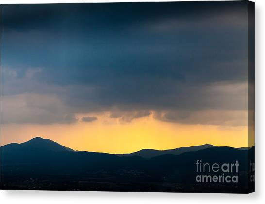 Overcast Dark Sky Rain Clouds With Yellow Glow Beyond Hills On H Canvas Print