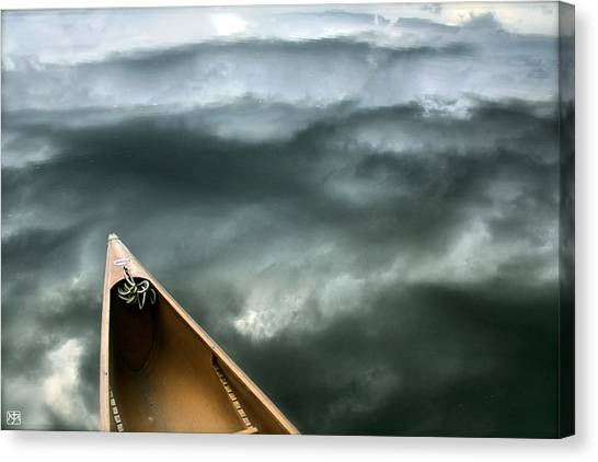 Paddling Before The Storm Canvas Print