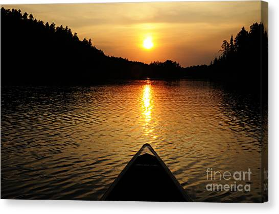 Paddling Off Into The Sunset Canvas Print