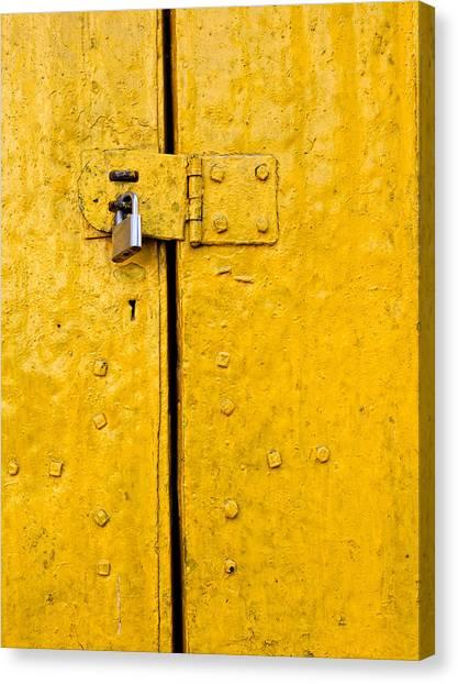 Padlock On An Old Yellow Door Canvas Print