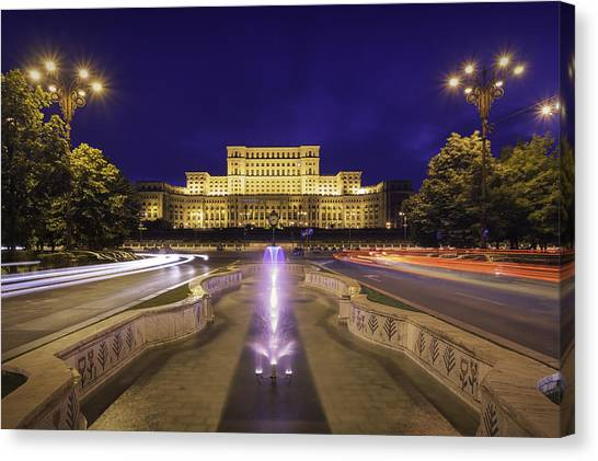 Palace Of Parliament At Night Canvas Print by LordRunar