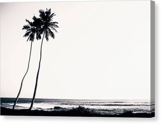 Palm Trees And Beach Silhouette Canvas Print by Chrispecoraro