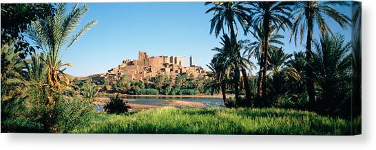 Sahara Desert Canvas Print - Palm Trees With A Fortress by Panoramic Images