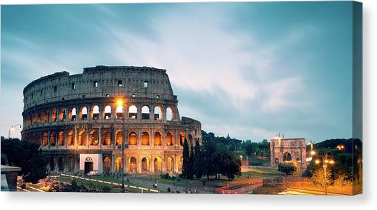 Panoramic Of The Colosseum At Night Canvas Print by Matteo Colombo