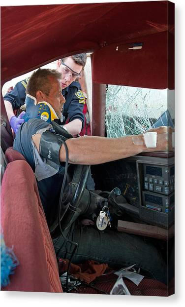 Mvc Canvas Print - Paramedic Assesses Trapped Victim by Kevin Link