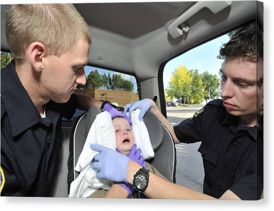 Mvc Canvas Print - Paramedic Immobilizing Infant by Kevin Link