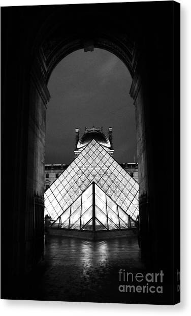 The Louvre Canvas Print - Paris Black And White Louvre Museum Art - Louvre Black And White Pyramid Night Lights And Arch by Kathy Fornal
