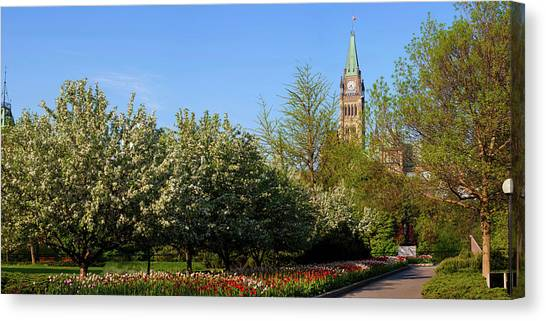 Parliament Hill Canvas Print - Parliament Building Seen From A Garden by Panoramic Images