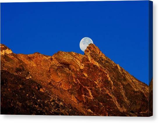 Peeking Full Moon Canvas Print by Rebecca Adams