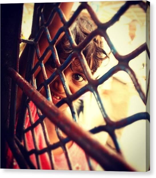 Innocent Canvas Print - Peeping #innocence. #smile #window by Ankit Ajmera