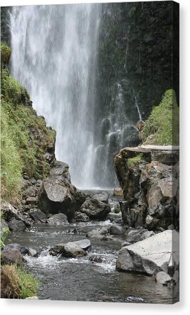 Peguche Falls Framed By Rocks Photograph By Robert Hamm
