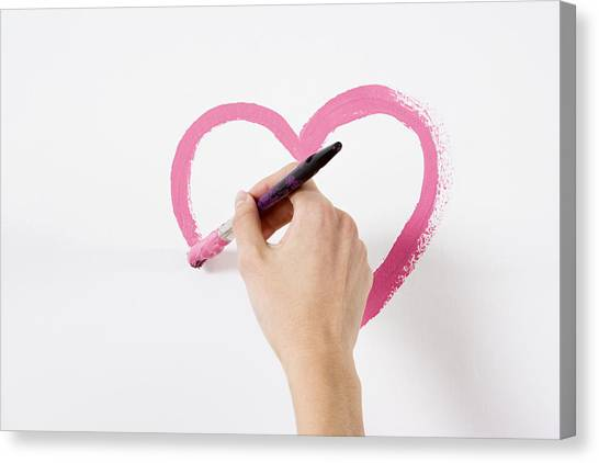 Person Painting A Heart Canvas Print by Image Source