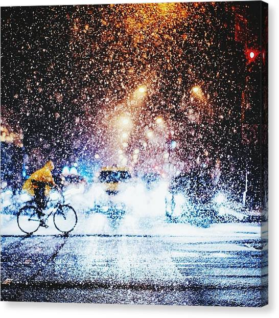 Person Riding Bicycle In Snowfall Canvas Print by Maclerin Mines / Eyeem