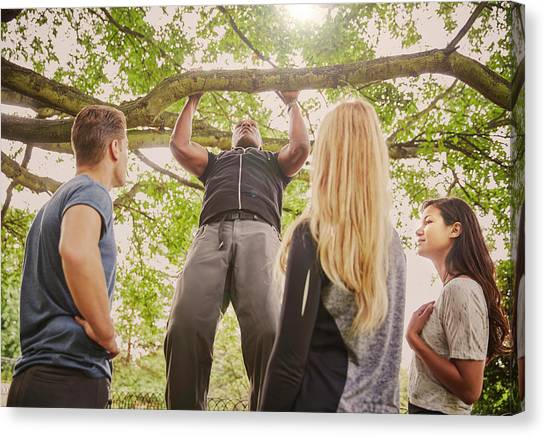 Personal Trainer Demonstrating Pull Ups Canvas Print