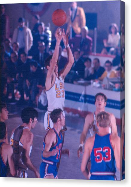 Pennsylvania State University Canvas Print - Pete Maravich Releasing Shot by Retro Images Archive