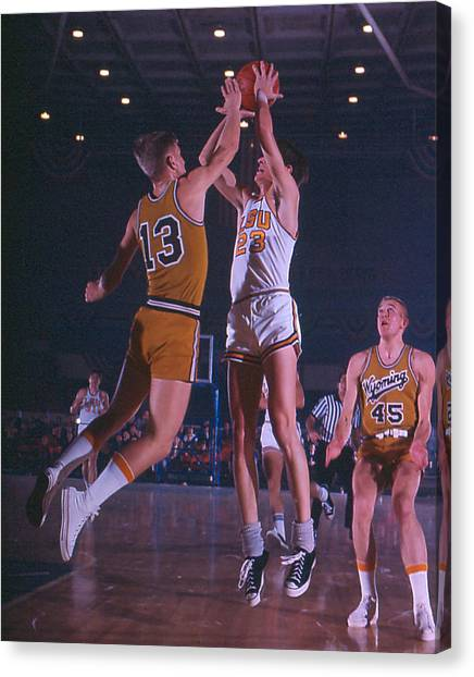 Atlanta Hawks Canvas Print - Pete Maravich Shooting Over Player by Retro Images Archive