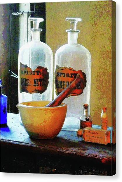 Pharmacist - Mortar And Pestle With Bottles Canvas Print