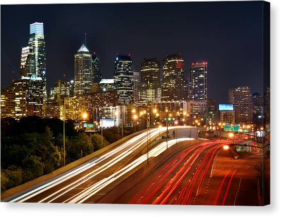 Philadelphia Skyline Canvas Print - Philadelphia Skyline At Night In Color Car Light Trails by Jon Holiday