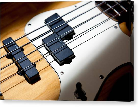 Bass Guitars Canvas Print - Pickup Lines by Peter Tellone