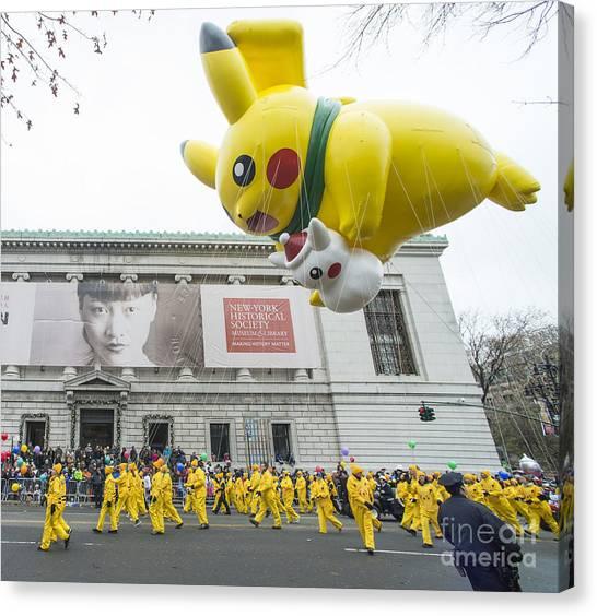 Macys Parade Canvas Print - Pikachu Balloon At Macy's Thanksgiving Day Parade by David Oppenheimer