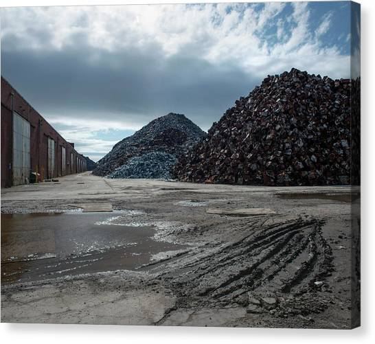 Piles Of Scrap Metal Canvas Print by Robert Brook