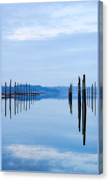 Pilings At Sea With Floating Docks Canvas Print by Tom Reese, www.wowography.com