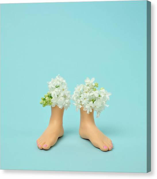 Vase Of Flowers Canvas Print - Plastic Feet Filled With Flowers by Juj Winn