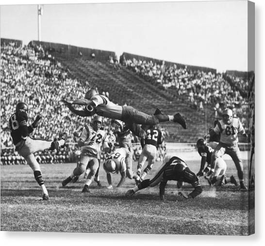 Hard Hat Canvas Print - Player Blocks Football Punt by Underwood Archives