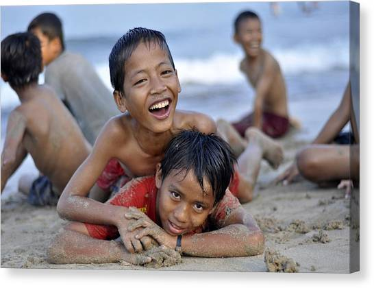 Playing On The Beach Canvas Print by Achmad Bachtiar