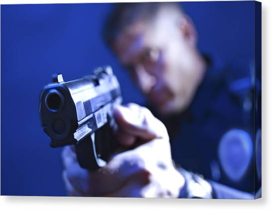 Police Officer Aiming Gun Canvas Print by Jupiterimages